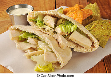 Chicken Sandwich on Pita Bread - Chicken Caesar Salad in a...