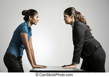 Angry Indian business women staring at each other - Indian...