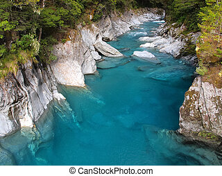 Beautiful Clear Blue Water at Haast Pass, New Zealand -...