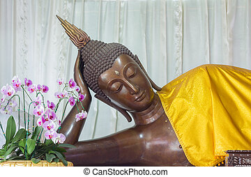 Sleeping Buddha Statue is in a temple in Thailand