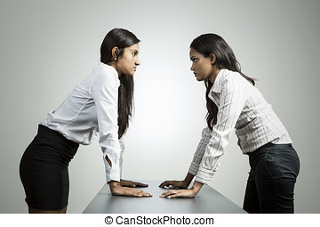 Angry Indian business women staring at each other. - Indian...