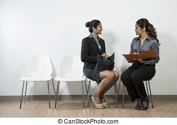 Interview applicant being asked a question - Indian woman...
