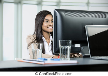 Indian business woman working in office