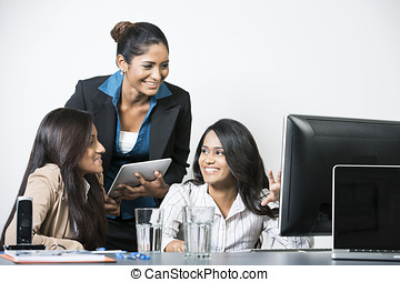 Indian business team. - Happy Indian business women working...