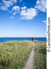Couple standing at Cliff Edge - Couple standing at end of...
