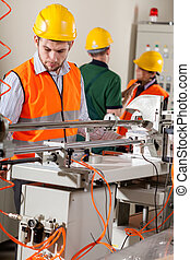 Production workers during job - Production workers doing job...