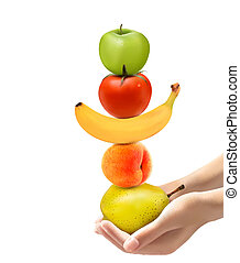 Hands holding a pyramid of healthy fruit. Diet concept....