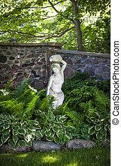 Shady perennial garden - Lush green summer garden with...
