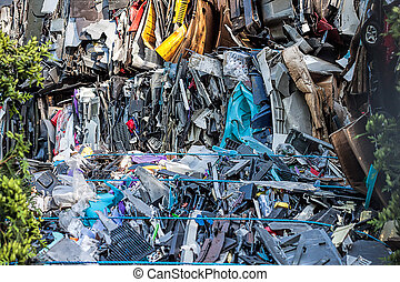 Recycling - Piled up compressed cars about to be recycled