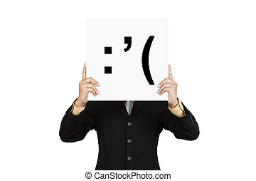 Businessman hold board with cry face emoticon isolated on...
