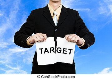 Businessman tear target paper on blue sky background