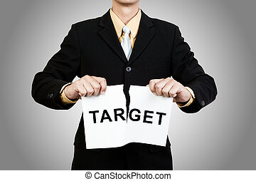 Businessman tear target paper on gray background