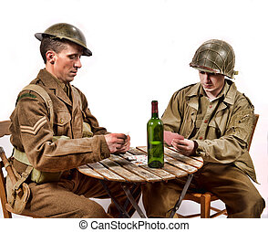 an English soldier and an American soldier playing cards on...