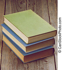 Old Books - Stack of Three Old Books isolated on Rustic...