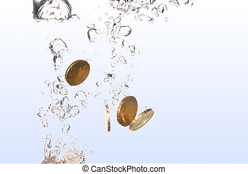 coins in water - money in water with bubbles on white...