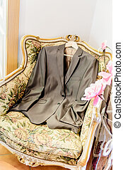 Grooms suit jacket lying on a seat