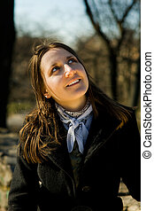 young woman looking up - smiling young woman with...