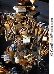 wedding padlocks - fence full of wedding locks on in sunset...