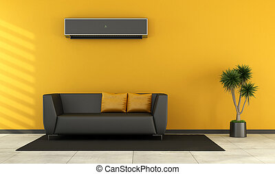 Modern living room with black couch and air conditioner on...