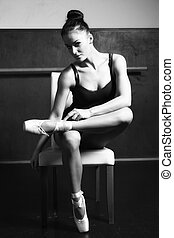 Young ballerina - a young ballerina in her chair, training...