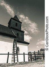 Black tower - Old tower of a church The peculiar uses of...