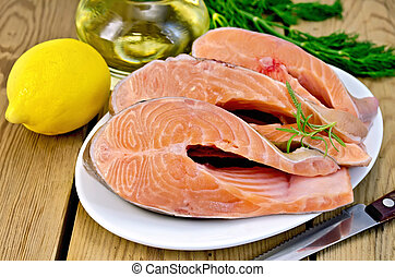 Trout in plate with lemon on board - Three pieces of trout...