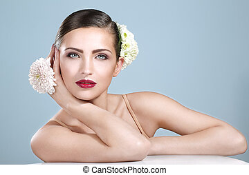 beauty shot of smiling woman with flowers accessories on...