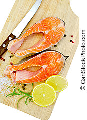 Trout with lemon and knife on plank - Two pieces of trout...
