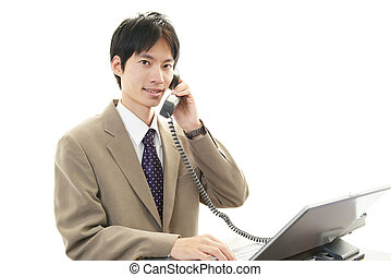Smiling Asian businessman - The male office worker who poses...
