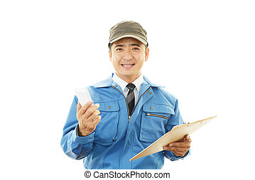 Courier Service - Smiling delivery man isolated on white...