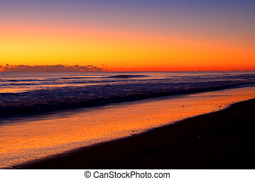 Orange sunrise color on long beach - Orange sunrise color on...