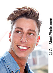 Casual young man smiling - Close up portrait of a casual...