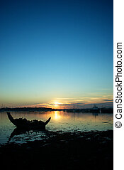 Sunset sea silhouette Oct-2-11 blue yellow reflection wreck...