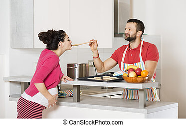 Pregnant couple - Pregnant woman and happy man in the...