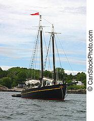 Black Schooner - A black Newfoundland schooner docked in...