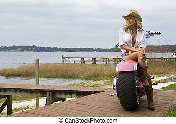 Biker Chick - A classic shot of an American blond sitting on...
