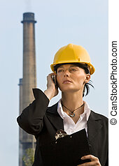 Women In Industry - A beautiful dark haired woman wearing a...