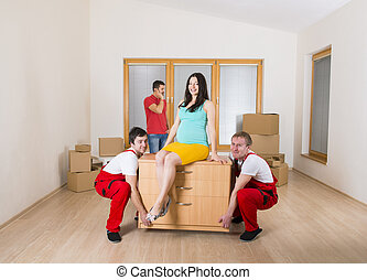 Movers in new house with young family