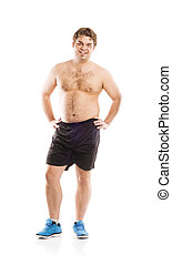 Fat fitness man - Fat young man is posing in studio on white...