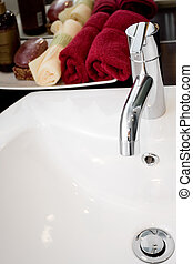 clean and modern washbasin with bathing supplies - tap of a...