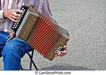 Accordian Man - Senior citizen playing a vintage accordion.