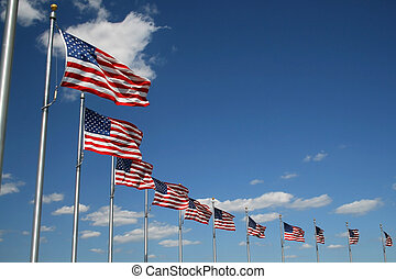 flags - American flags flying with blue sky background