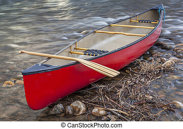 red canoe with a paddle