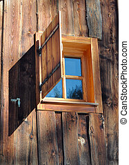 window on a wooden cottage