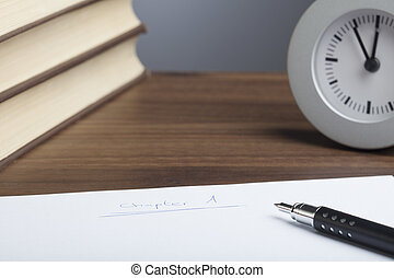 Bullet pen, books, clock, empty paper - Black bullet pen,...