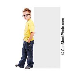 Stylish boy leaning to blank board