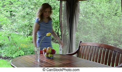 woman eat apple bower - Blond woman sit on wooden bench in...