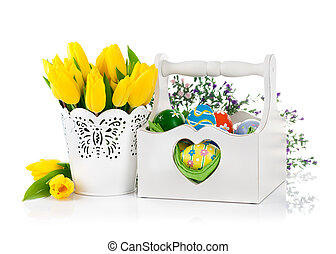 Easter eggs in basket with spring flowers. Isolated on white...