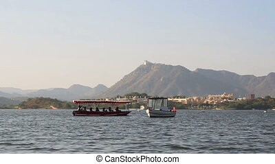 boat floating on Pichola lake in Udaipur India