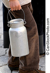 old bin to transport the milk brought by a young boy -...